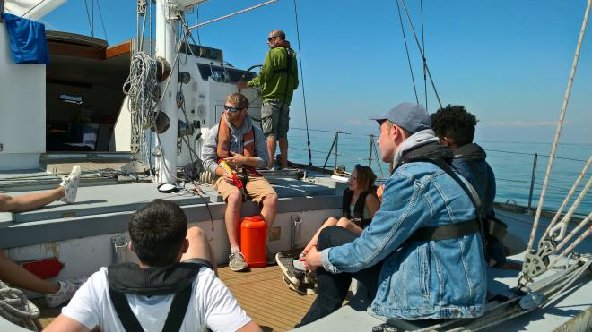 Group of students on a boat in the middle of the sea during Tall Ships residential trip 2018.